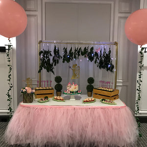 fairy themed party dessert table with cake