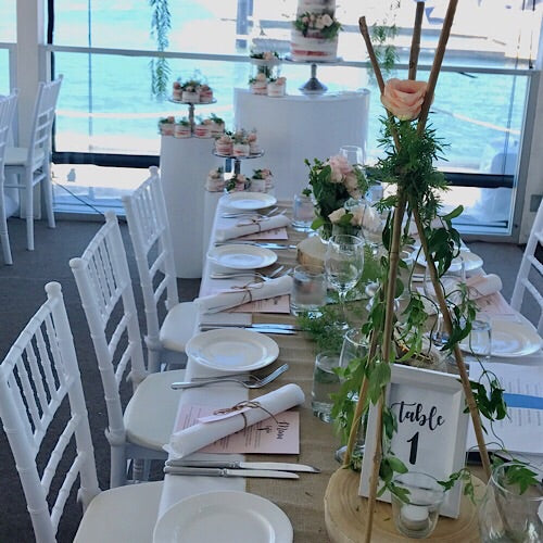 white tiffany chairs for an engagement set up