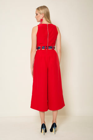 Red crepe satin two-piece jumpsuit tied with a signature MagnaDi silk scarf