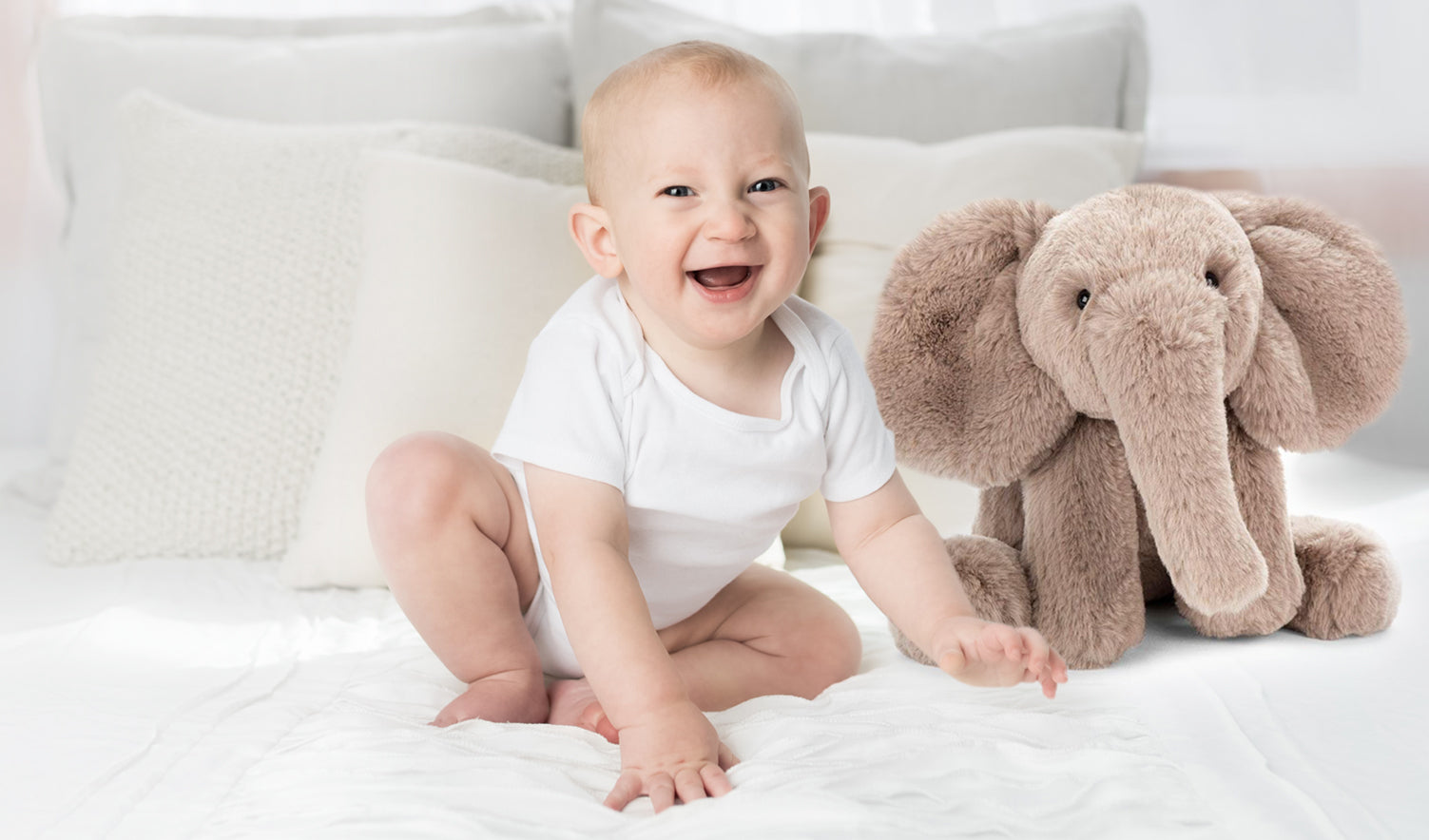 Baby with Stuffed Elephant toy