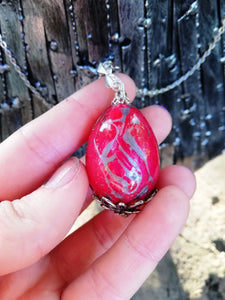 Red Dragon egg pendant with metal filigree detailing - Geek And Artsy