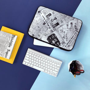 Archival Inquirer Laptop Sleeve with Keyboard and Archival Inquirer Journal on blue background