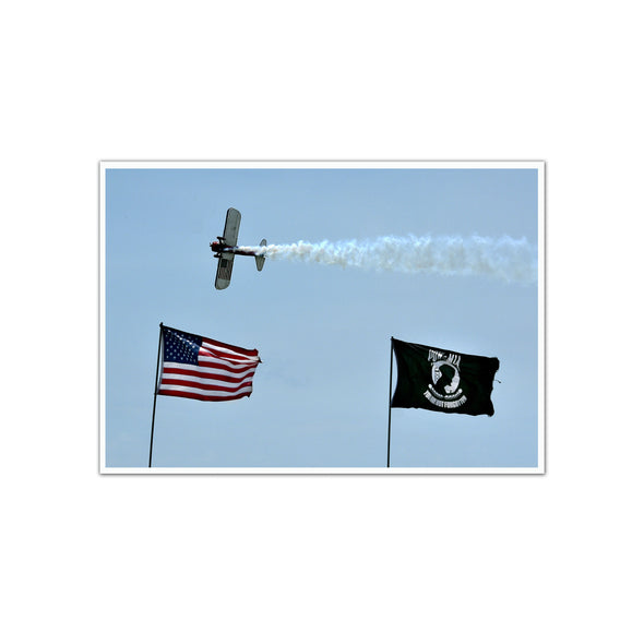PT-17 Stearman Flying over US and POW/MIA Flags at Air Show, Unframed Print by Tom Gralish