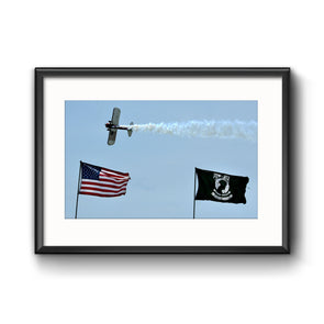 PT-17 Stearman Flying over US and POW/MIA Flags at Air Show, Framed Print with Mat by Tom Gralish