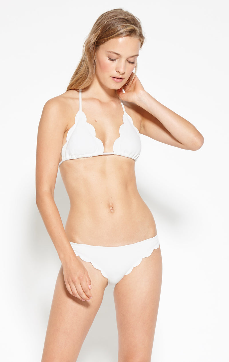 A bikini brief with moderate coverage with scalloped edges