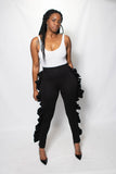 Love Dujour Black stretch pants with ruffles on the side inseam paired with a white bodysuit