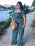 navy blue tropical print wide leg plus size jumpsuit with front waist tie and v wire front