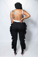 Ruffles are it this season! Get into the trend with our hot Ruffle Me pants. Available in black, white, and gray