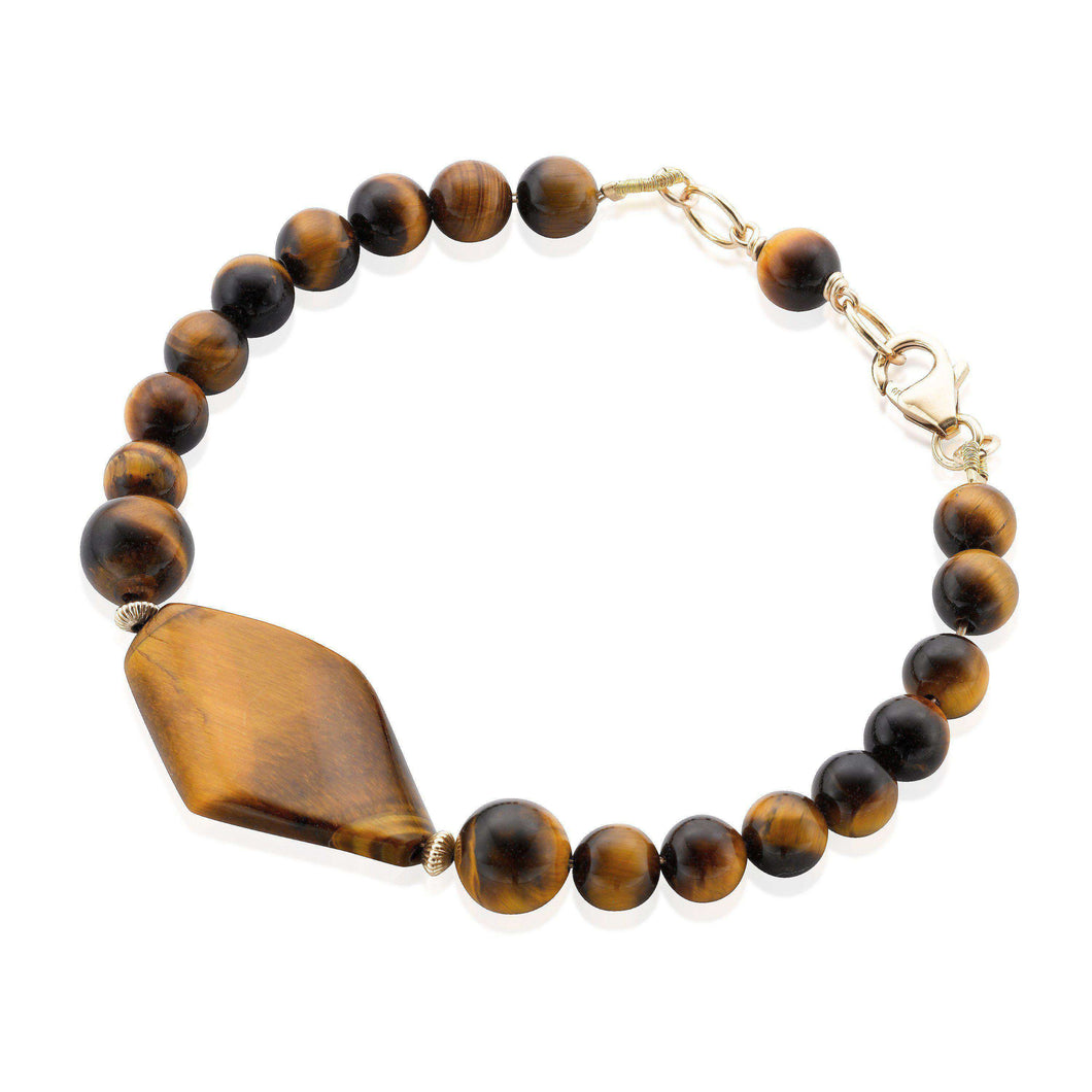 Modern and sleek Tiger's Eye gemstone bracelet accented with Gold filled rondelle beads and clasp.