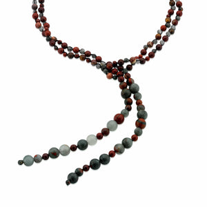 A long necklace of cabochon cut red Apple and green African Jasper gemstones.