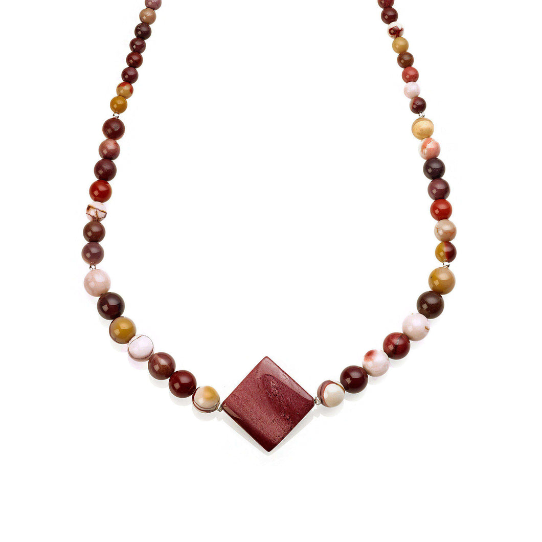 Elegant and colourful one row necklace made of Mookaite gemstones, featuring a diamond shaped larger central stone as a main feature, which graduates down to smaller round beads at both ends.