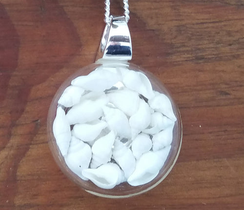 Pendant filled with  White Tiny Shells