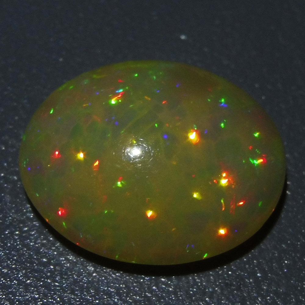Opal 5.55 cts 16.14x13.41x6.24mm Oval Cabochon Base Color: Orangey Yellow  $195