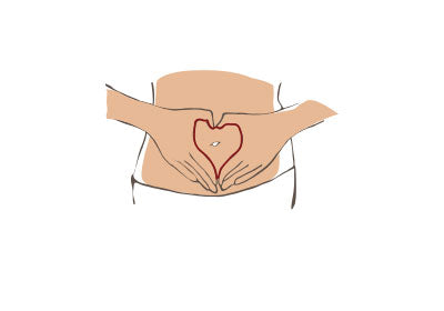 hands covering tummy in shape of a heart icon