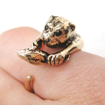 Otter Holding a Fish Shaped Animal Wrap Around Ring in Shiny Gold | US Sizes 4 to 9 | DOTOLY