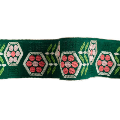 Pink hex flowers on green - by 1/2 yd