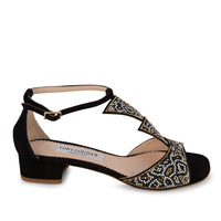 black sandals with Sworavski crystal embellishments and a slight heel