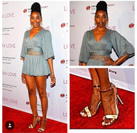 Actress Erica Ash wearing multicolored strappy sandals