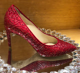 red pumps with mid heel height and  laser design