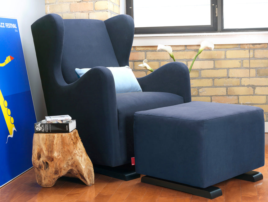 Modern Vola Glider and Ottoman - navy blue with light blue pillow shown.