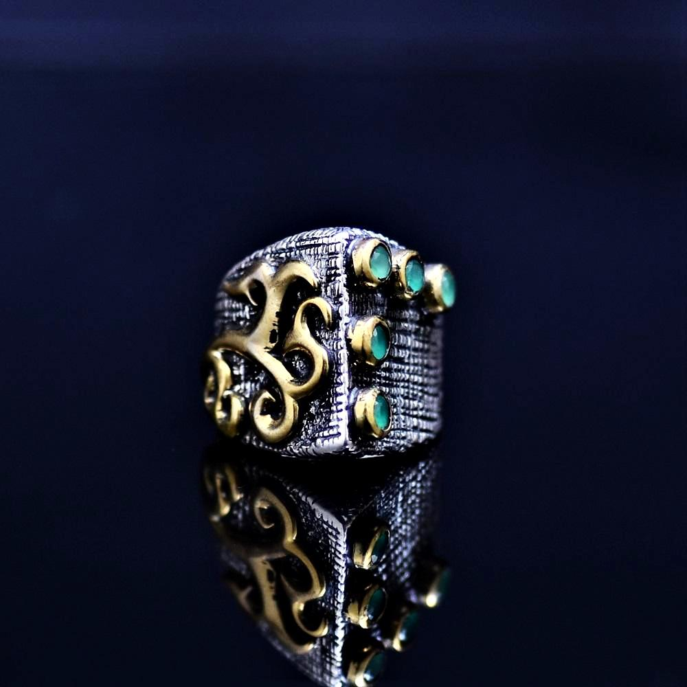 Silver Ring Adorned With Lab Created Emerald Stones