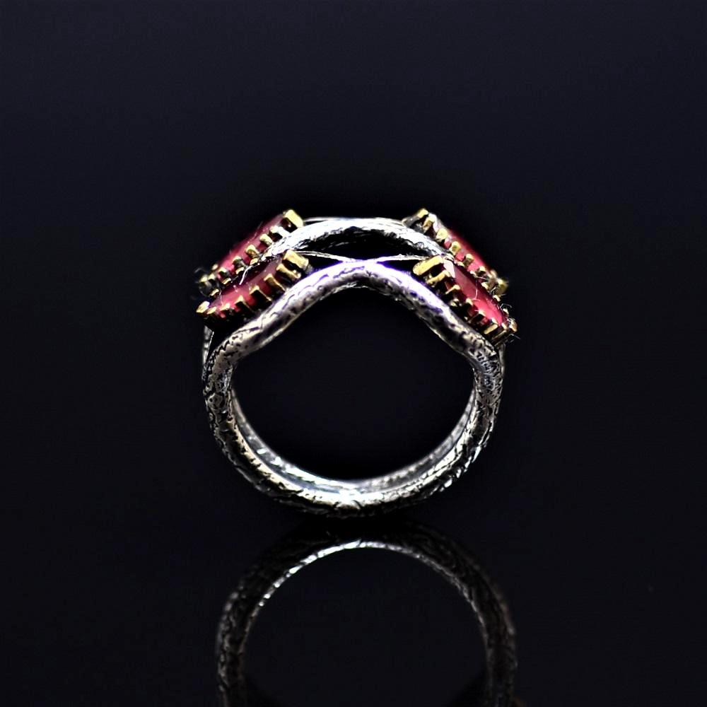 Silver Ring Adorned With Lab Created Ruby Stones