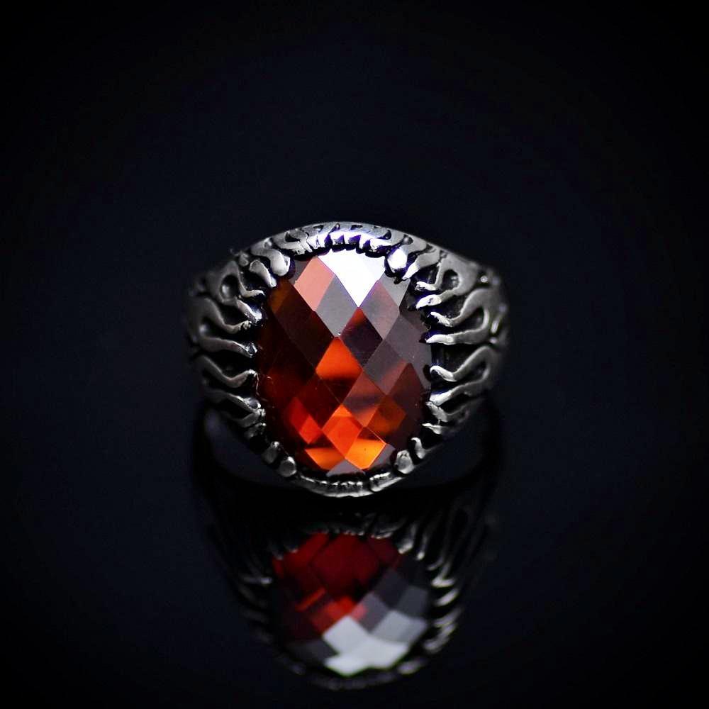 Silver Flame Ring Adorned With Garnet Stone And Flame Motifs Front