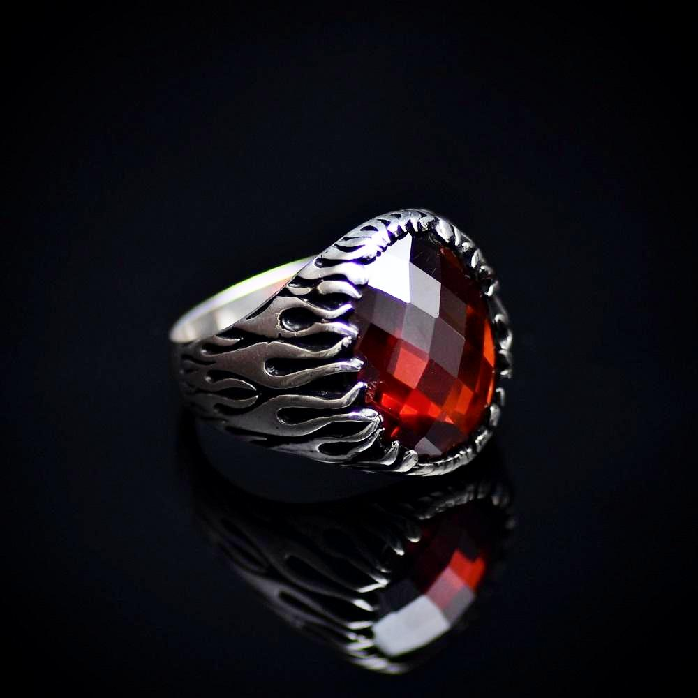 Silver Flame Ring Adorned With Garnet Stone And Flame Motifs Left