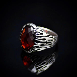 Silver Flame Ring Adorned With Garnet Stone And Flame Motifs Right