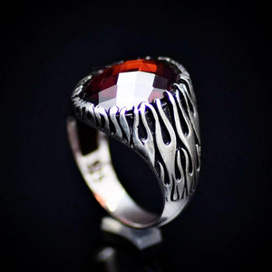 Silver Flame Ring Adorned With Garnet Stone And Flame Motifs