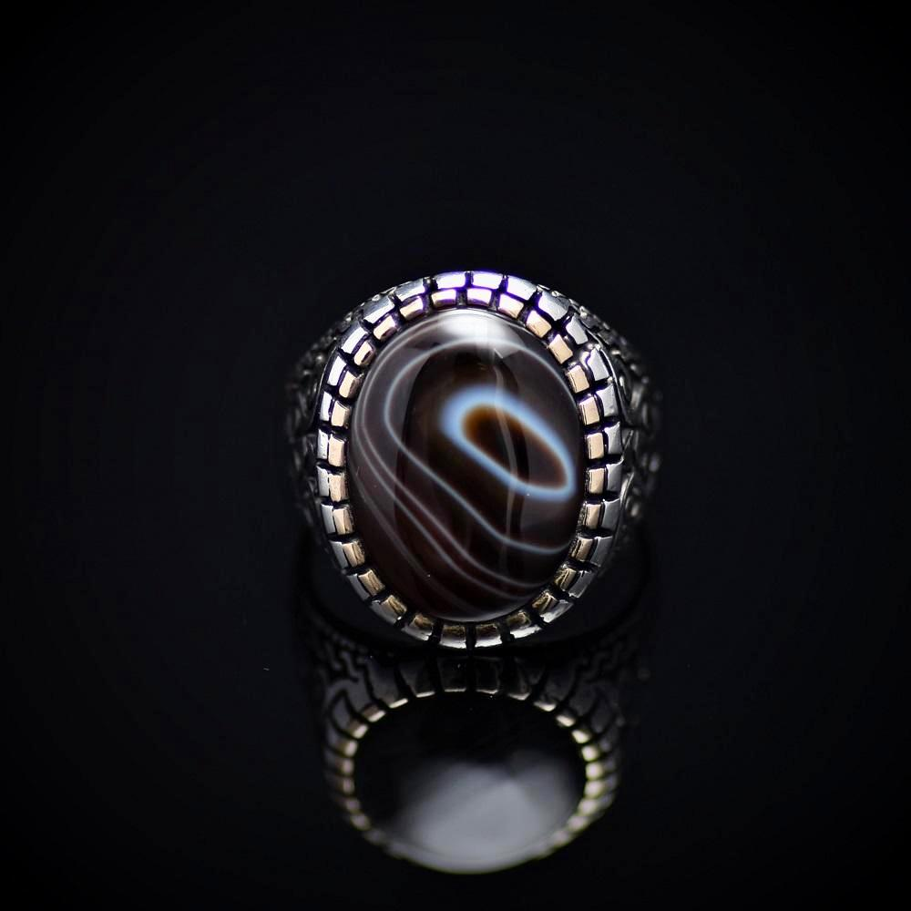 Top Of The Line Silver Ring Adorned With Black Banded Agate Stone Front