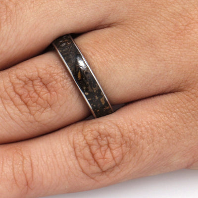 finger wearing Wedding Band With Wood Inside