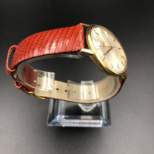 Vintage Omega watch with red lizard strap
