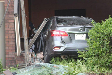 Car after going through a wall at the Parsippany Hilton (Parsippany Focus)