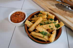 Polenta frites, AKA grits fries with tomato caper dipping sauce