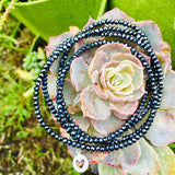 Sterling Silver Heart on Midnight Dark Crystal Wrap Bracelet for Self Love. Wear this bracelet as a reminder that Love starts with Self Love. If you don't love yourself, you can not love others, said the Dalai Lama. It is such a truth basic statement, yet many of us have a hard time living by the advice.