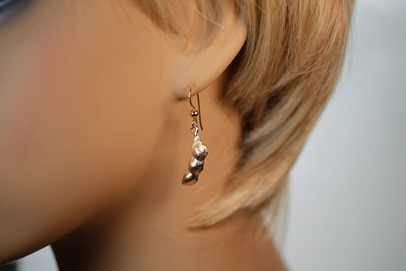Whole Soybean Dangle Earrings in 14kt Gold Vermeil on model ear
