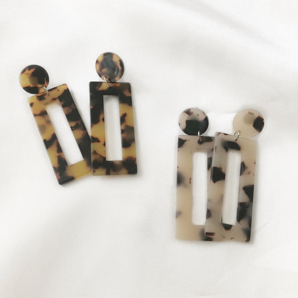 Georgia Earrings is made up of a lightweight circular pin stud, fastened with a long rectangular semi translucent hollow flat disc. Available in two tortoise shell patterns.