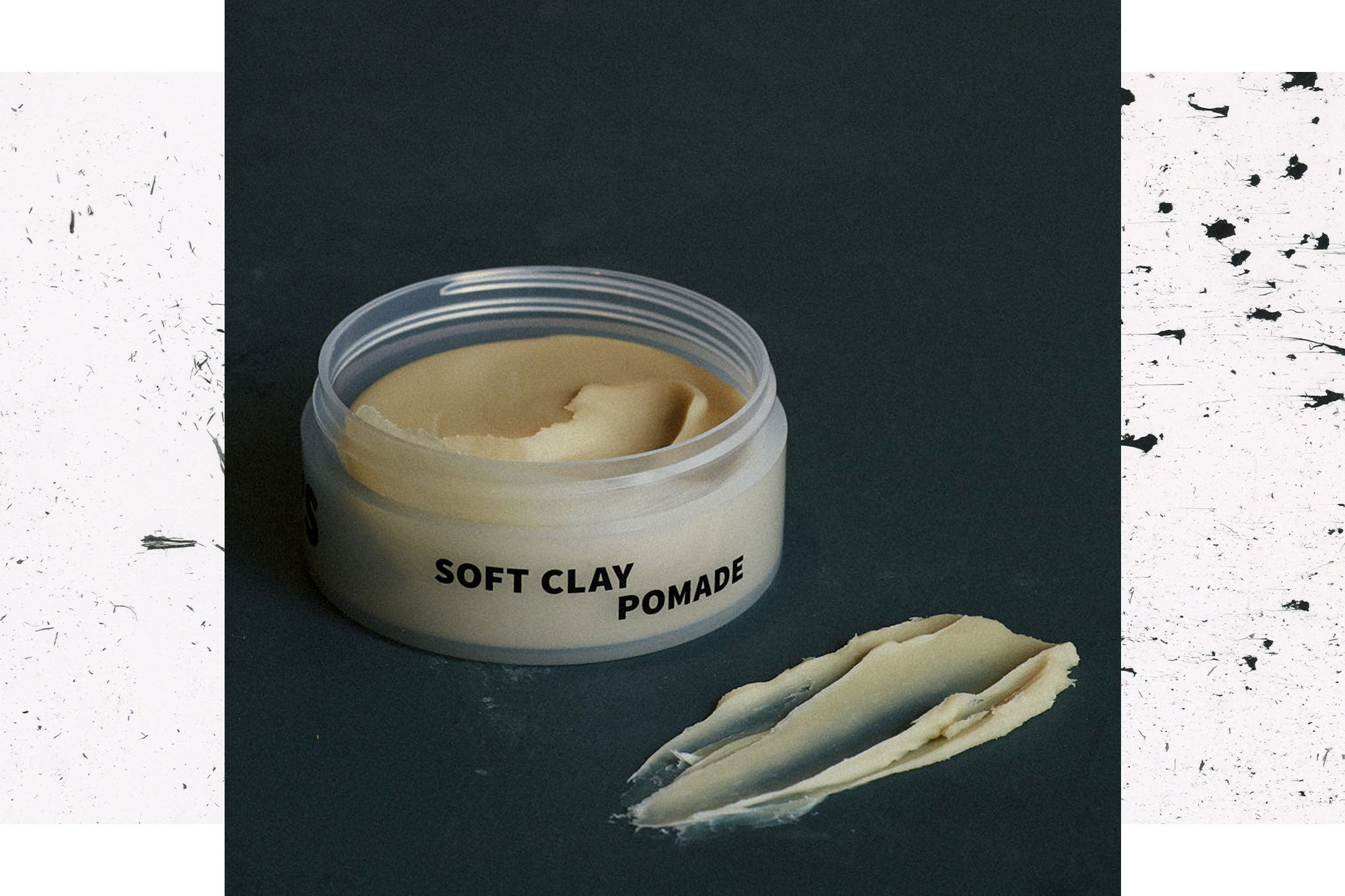 Image of Soft Clay Pomade on dark background with a swipe of product in the foreground