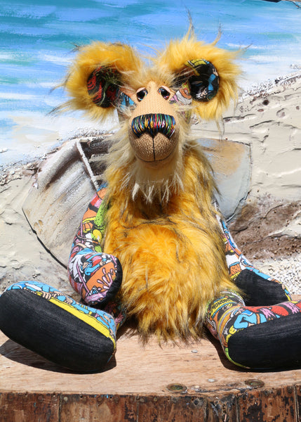 Wally is a magnificent, comical and joyful, one of a kind, artist bear by Barbara-Ann Bears in a printed cotton, mohair and faux fur, standing 23.5 inches (60 cm) tall and 18 inches (46 cm) sitting. Wally is mostly made from a 'Where's Wally?' fabric depicting a coastal town full of sailors being overrun by sea monsters