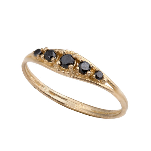 14k gold ring with 5 black diamonds