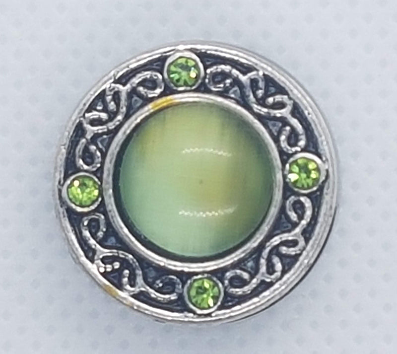 Antique snap with large green stone and small green rhinestones