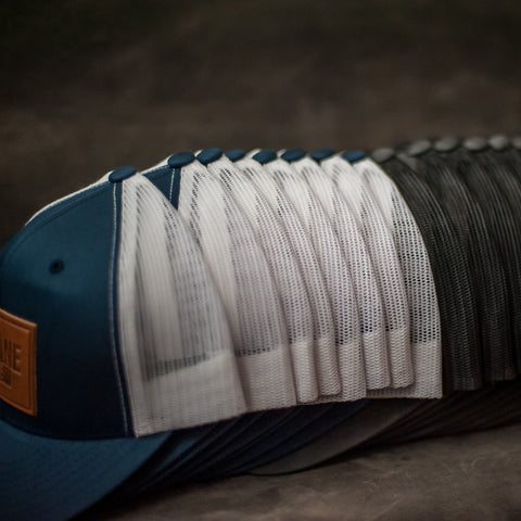 Stack of Leather Patch Trucker Hats for Family Reunions - Ox & Pine Leather Goods