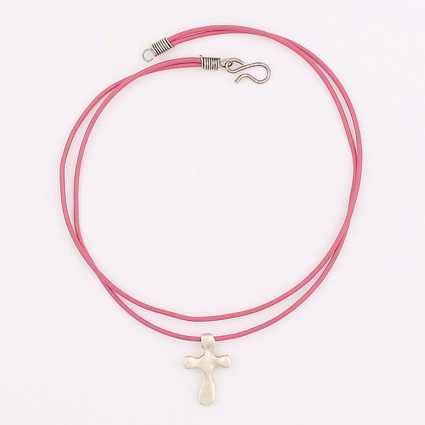 Contemporary cross on pink leather