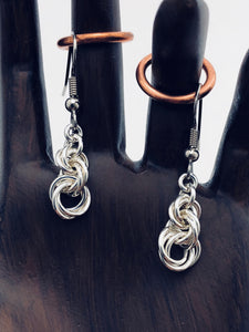"seaXwolf fine handmade jewelry solid sterling silver chain earrings entitled ""Twisted Roses"" because they look like a tiny bouquet of budding roses."
