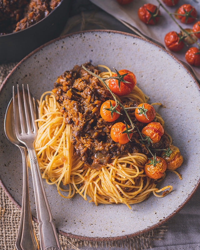 vegan black lentil bolognese with roast eggplant