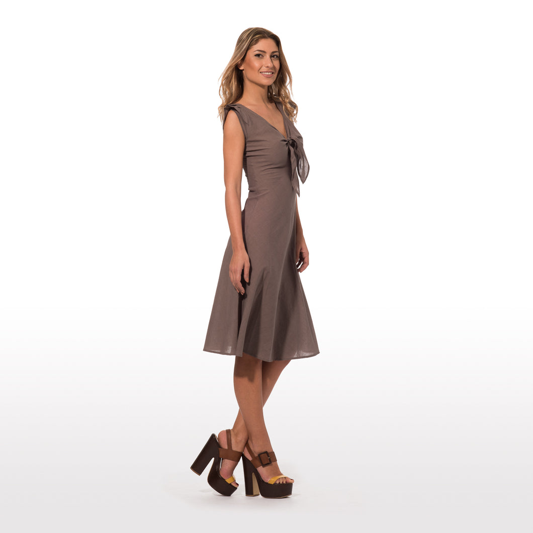 elegant summer dress with epaulettes in pure cotton in solid color  with knot in the front