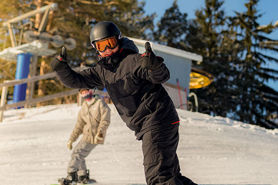 Snowboarder giving thumbs up
