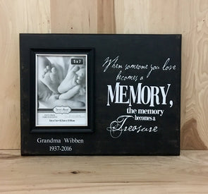 Personalized memorial wood sign with attached picture frame.