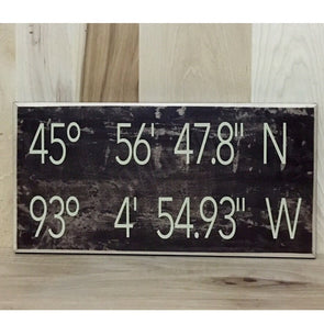 Personalized wood sign with coordinates.